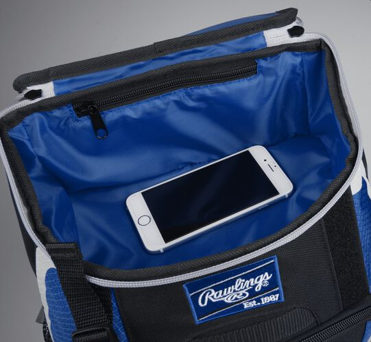 Top accessory pocket of a black/royal R500 equipment backpack holding a phone