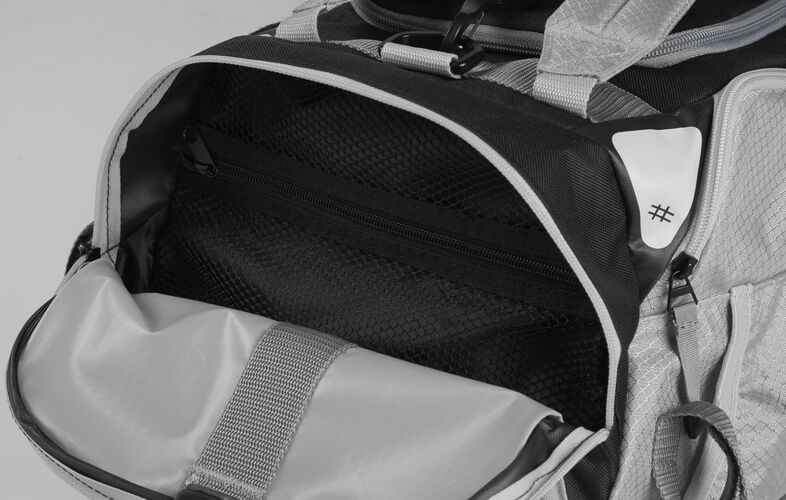 Side pocket of a white R601 hybrid backpack/duffel bag with a mesh compartment