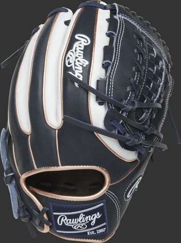 PRO716SB-18NW 12-inch Heart of the Hide softball glove with a navy back, white trim and rose gold double-welting
