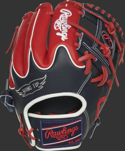 Navy/scarlet Wing Tip back of a Cleveland Indians Heart of the Hide I-web glove with a navy Rawlings patch - SKU: RSGPRO204W-2CLE