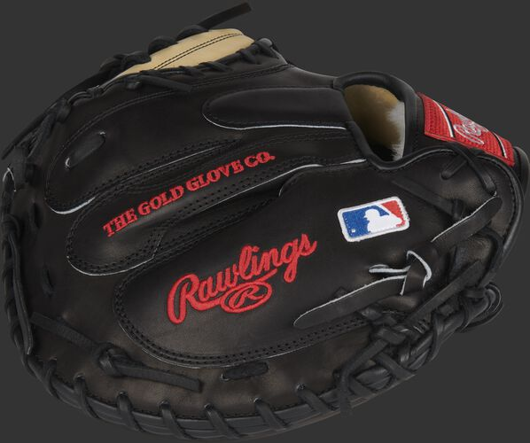 A black Pro Preferred catcher's mitt with the MLB logo on the pinky - SKU: PROSCM43JR10