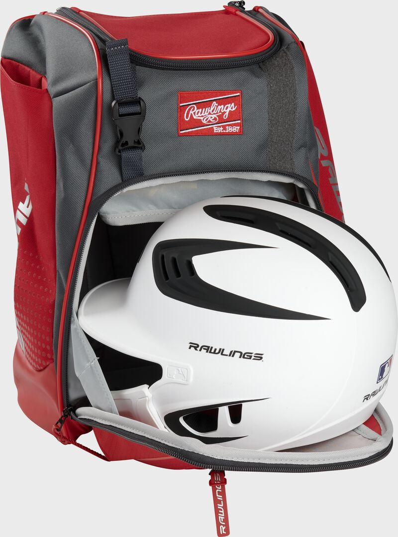A white/black helmet in the main compartment of a scarlet Rawlings Franchise backpack - SKU: FRANBP-S