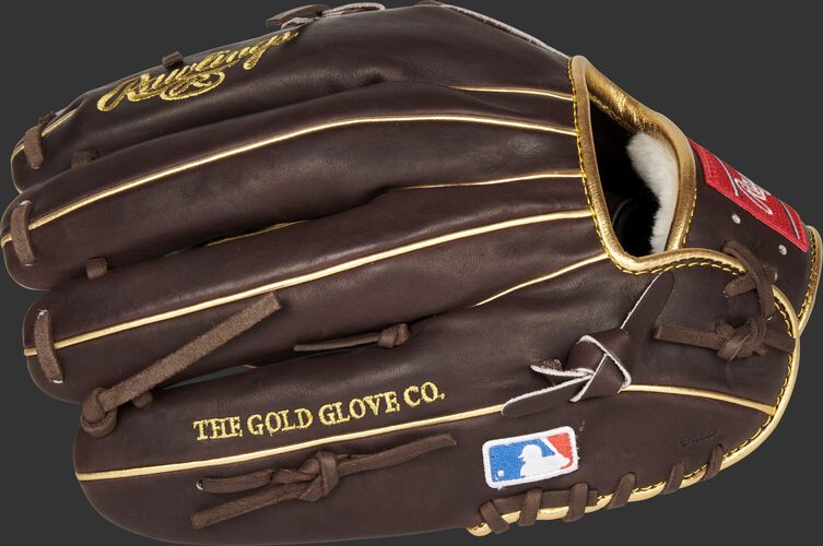 Mocha finger backs of a Rawlings Pro Preferred Manny Machado glove with the MLB logo on the pinky - SKU: PROSNP7-MM13