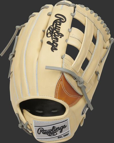 A Heart of the Hide H-web outfield glove with a camel back and silver Rawlings patch - SKU: PRO3039-6TC