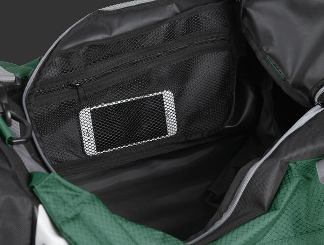 A phone inside the mesh accessory pocket inside the main compartment of a dark green R601 Hybrid bag