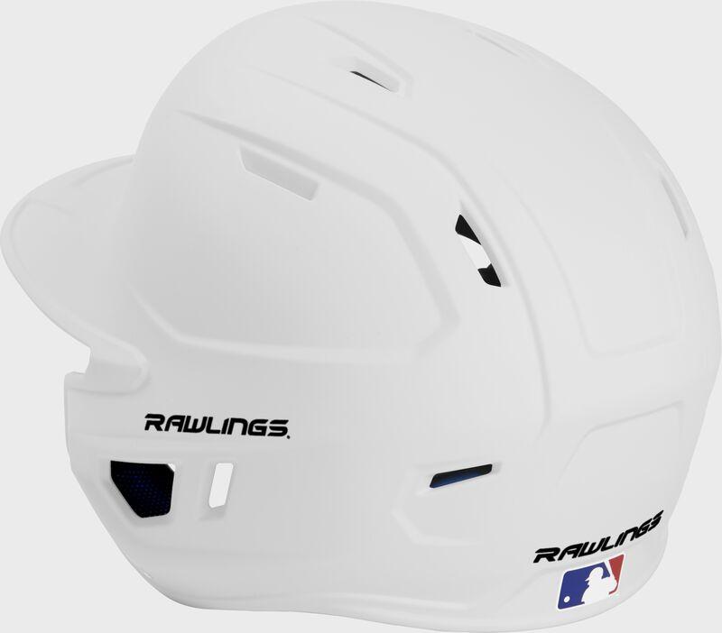 Back left view of a matte white MACHEXTL MACH series batting helmet with air vents