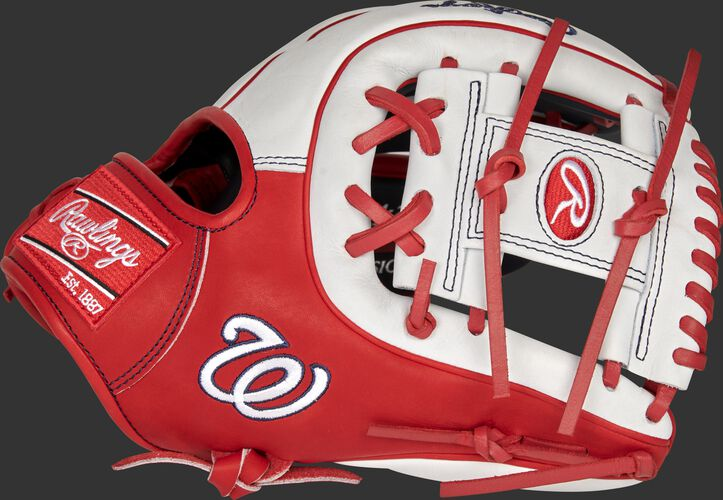 Thumb of a scarlet/white 2021 Washington Nationals Heart of the Hide glove with the Nationals logo on the thumb - SKU: RSGPRO314-2WSH