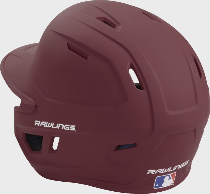 Back left view of a matte maroon MACH series batting helmet with air vents