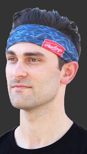 A guy wearing a navy Rawlings multi-purpose neck gaiter as a head band - SKU: RC40005-400