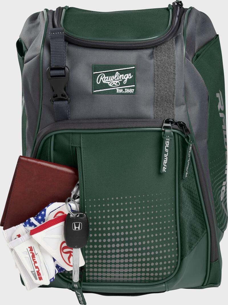 Wallet, keys, and batting gloves in the front valuables pocket of a dark green Franchise baseball bag - SKU: FRANBP-DG