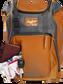 Wallet, keys, and batting gloves in the front valuables pocket of an orange Franchise baseball bag - SKU: FRANBP-O image number null
