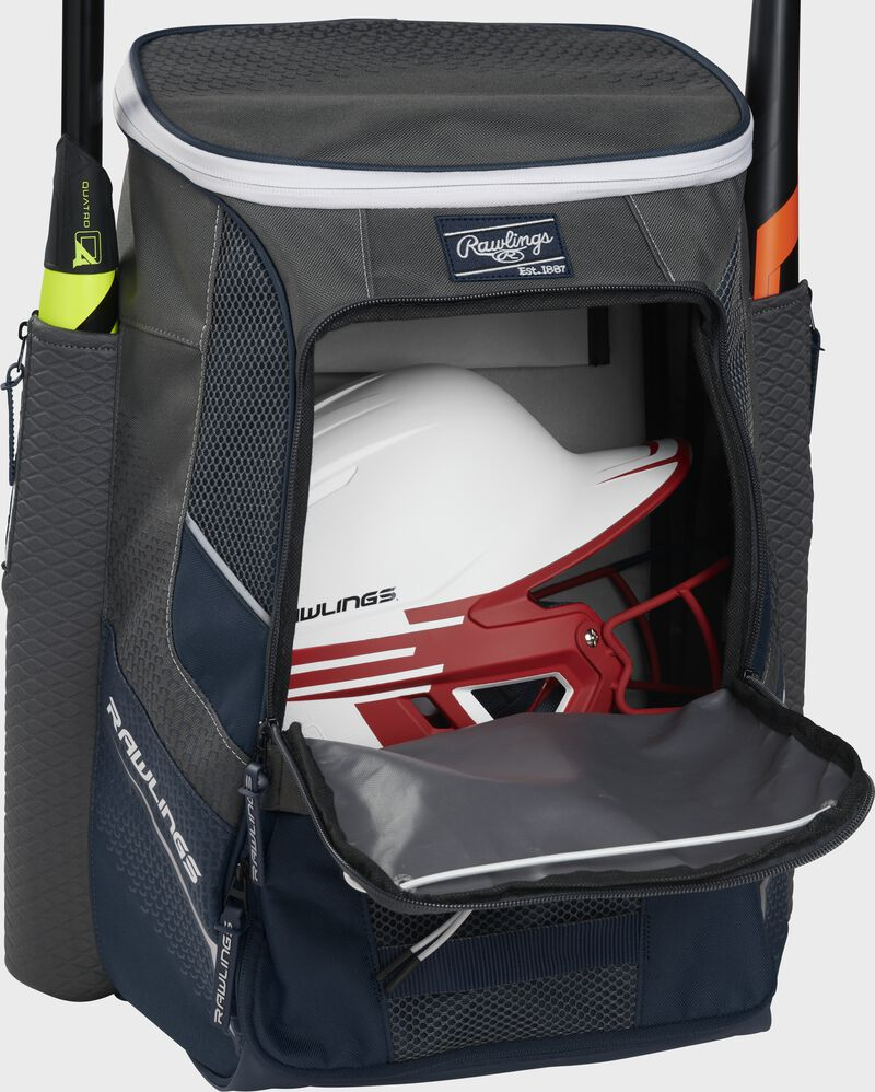 A navy Impulse baseball backpack with a helmet in the main compartment - SKU: IMPLSE-N