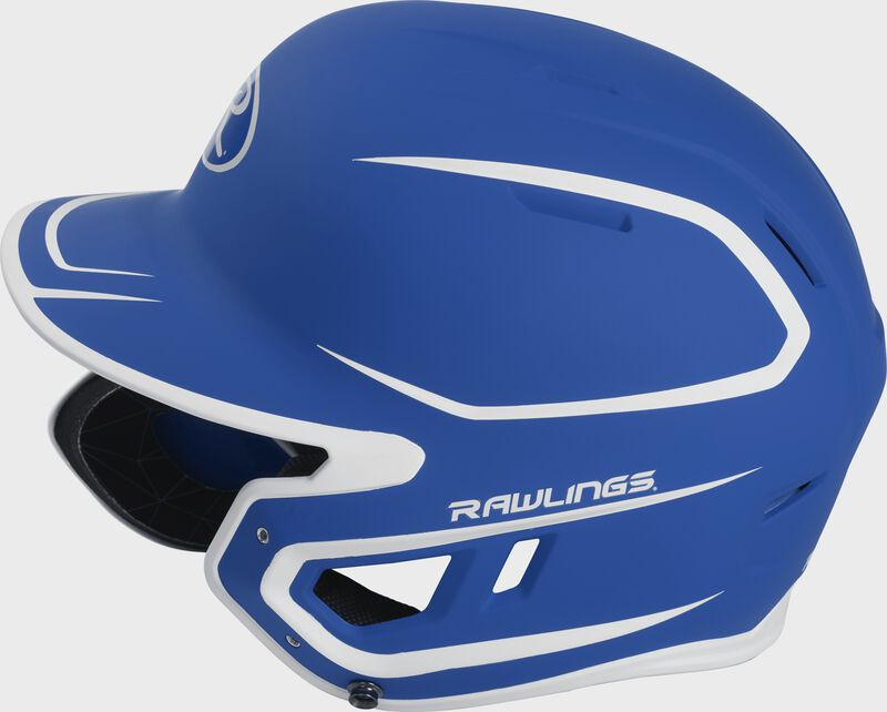 Left side of a MACHEXTR junior Rawlings batting helmet with a two-tone matte royal/white shell