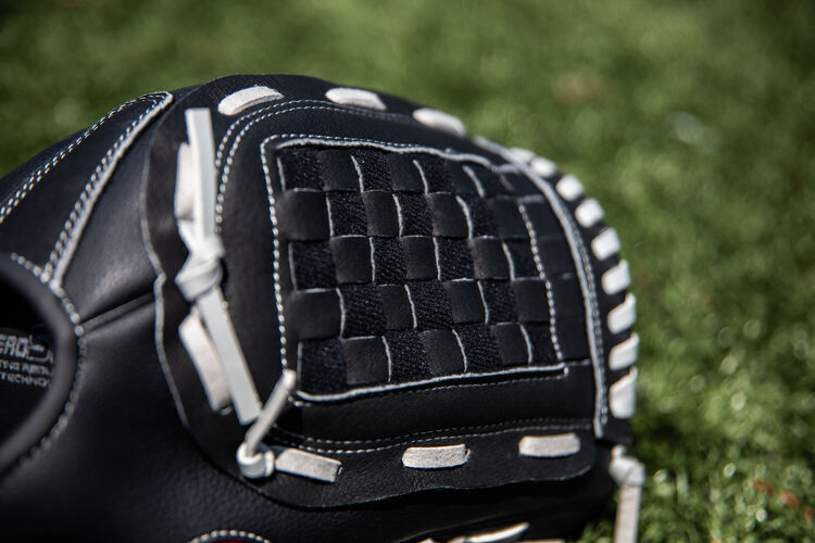 Black Basket web on a Rawlings Softball Series softball glove with a field in the background - SKU: RSB125GB