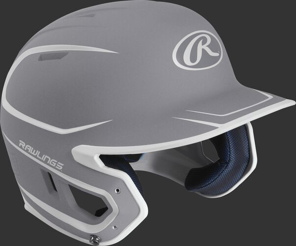 Right angle view of a matte MACH Senior batting helmet with a silver/white shell