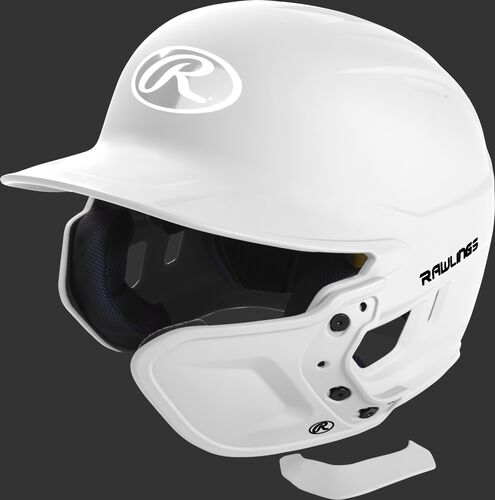 A matte white MEXT attached to a Mach batting helmet showing the hardware
