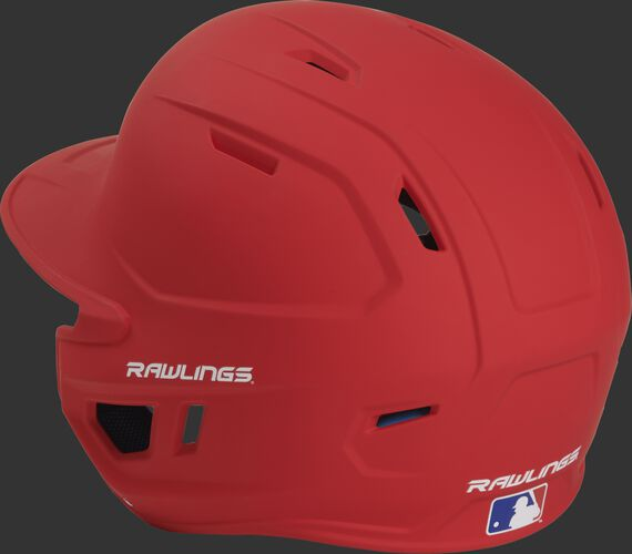 Back left view of a matte scarlet MACHEXTL MACH series batting helmet with air vents