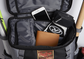 The top compartment on black/gray Gold Glove Series backpack with a wallet, phone and batting gloves image number null