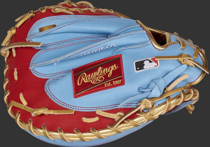 Columbia blue back of an exclusive Heart of the Hide catcher's mitt with a red Rawlings patch and MLB logo - SKU: RSGPROYM4SCBG