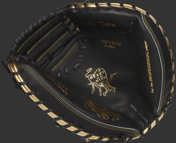 Black palm of a Rawlings Heart of the Hide catcher's mitt with gold stamping and black laces - SKU: RSGPROYM4G