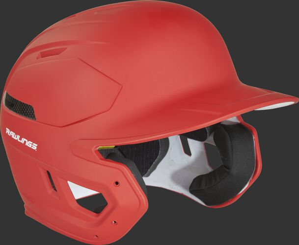 Right angle view of a CAR07A Rawlings MACH Carbon helmet with a matte scarlet shell