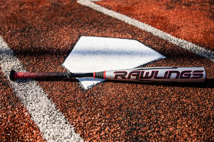 A Rawlings USA -8 Quatro Pro baseball bat on a field next to home plate with a black Rawlings logo - SKU: US1Q8