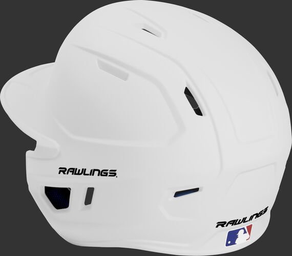 Back left view of a matte white MACHEXTL MACH series batting helmet with air vents