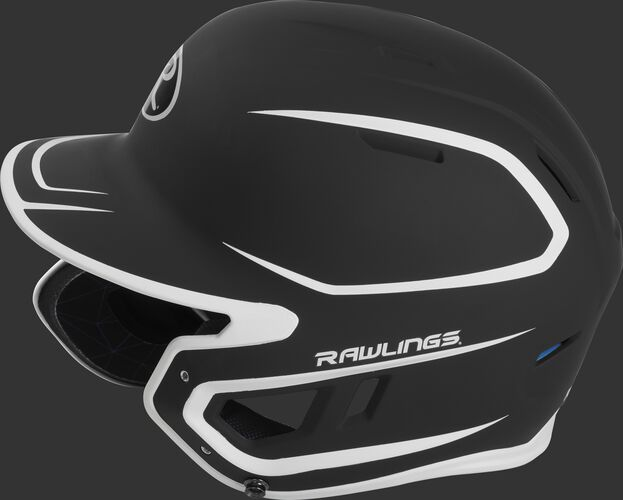 Left side of a MACHEXTR junior Rawlings batting helmet with a two-tone matte black/white shell