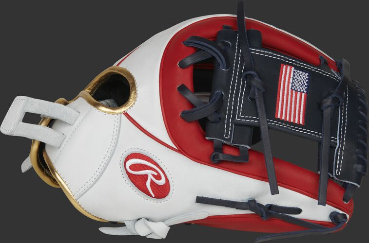 Thumb of a white/scarlet PRO716SB-2USA Heart of the Hide 12-Inch USA softball glove with a USA flag on the navy I-web