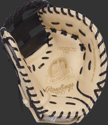 Palm view of a PROSDCTC Rawlings 13-inch first base mitt with a camel palm and black laces