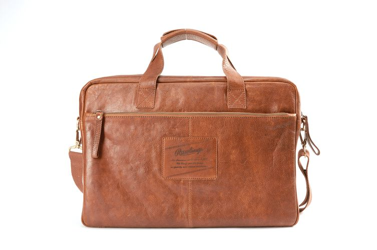 Back of a tan rugged briefcase with a side zip compartment and leather Rawlings logo in the middle - SKU: V609-202
