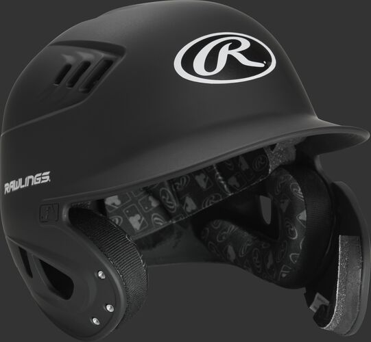 Angle view of a matte black Rawlings baseball helmet with face extension piece for a right handed batter - SKU: R6E07R