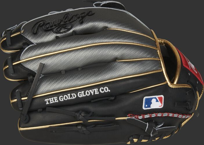 Fingers of a Bryce Harper model HOH Hyper Shell glove with the MLB logo on the pinkie - SKU: PROBH3
