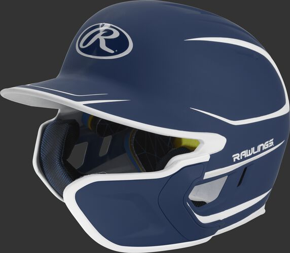 Left angle view of a matte navy/white MACHEXTR Mach Senior helmet with Mach EXT right hand batter face guard extension