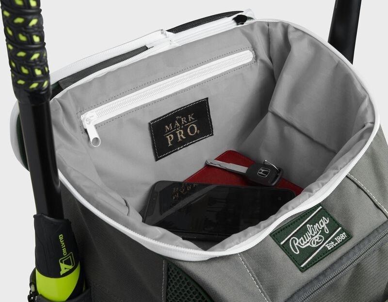 """Top compartment of a dark green Impulse bag with a phone, keys and black """"The Mark of a Pro"""" patch - SKU: IMPLSE-DG"""