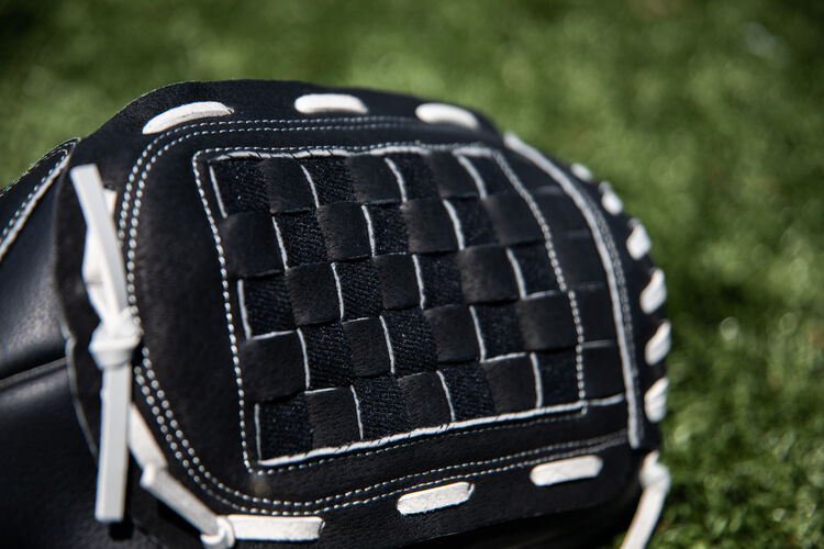 Black Basket web of a RSB recreational glove with a field in the background - SKU: RSB140GB