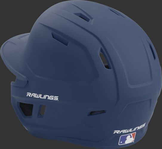 Back left view of a matte navy MACH series batting helmet with air vents