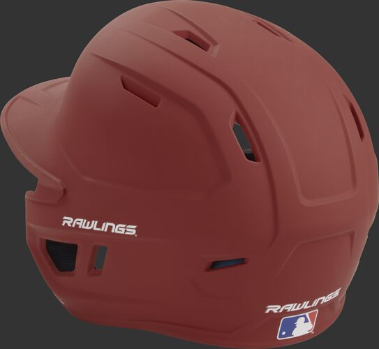 Back left view of a matte cardinal MACH series batting helmet with air vents