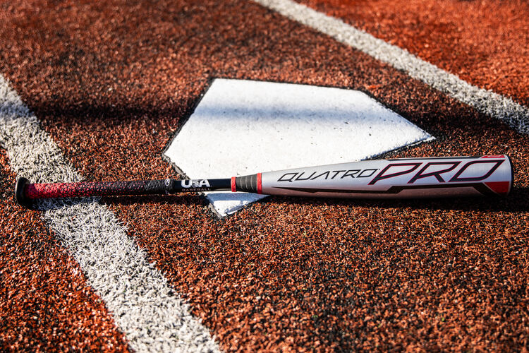 A gray USA -8 Quatro Pro on a field next to home plate - SKU: US1Q8