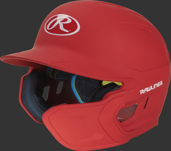 Left angle view of a matte scarlet MACHEXTR Mach Junior helmet with Mach EXT right hand batter face guard extension