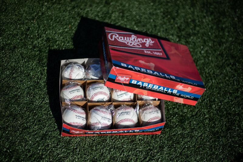 An opened box of a dozen Rawlings Cal Ripken baseballs - SKU: RCAL1