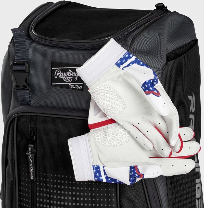 Two batting gloves hanging on the front Velcro strap of a Franchise baseball backpack - SKU: FRANBP-B