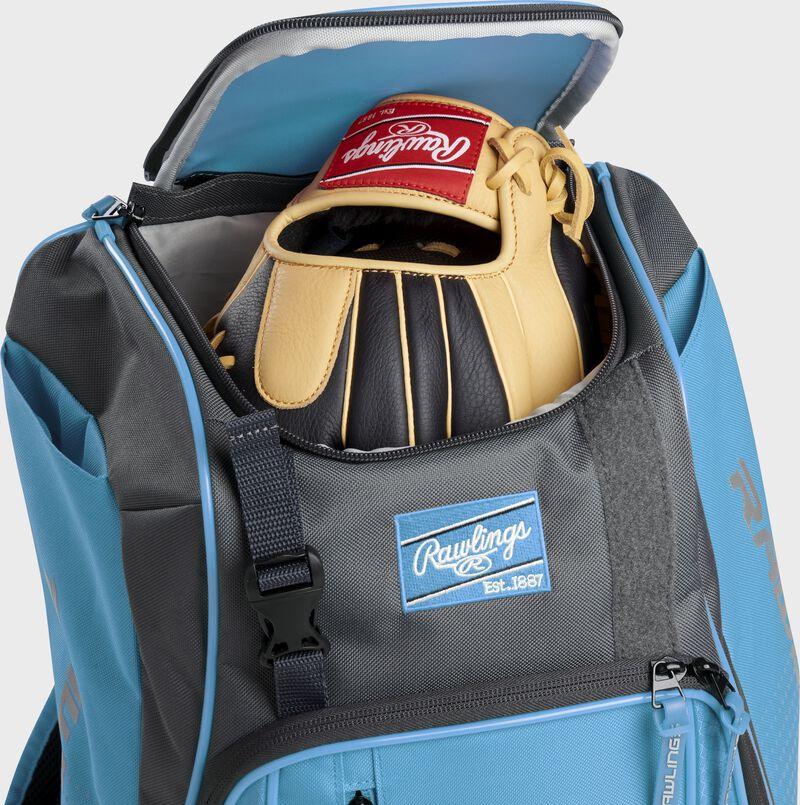 A Rawlings baseball glove in the top compartment of a Franchise baseball backpack - SKU: FRANBP-CB