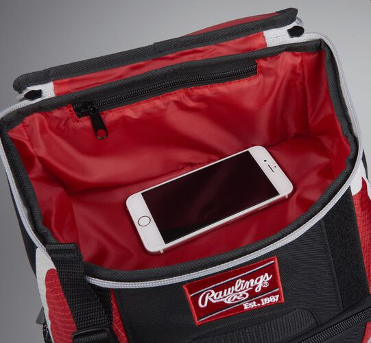 Top accessory pocket of a black/scarlet R500 equipment backpack holding a phone