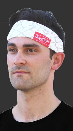 A guy wearing a white Rawlings multi-purpose neck gaiter as a head band - SKU: RC40005-100