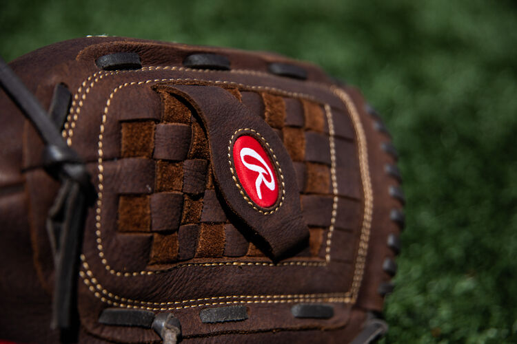 Brown Basket Web on a Rawlings Player Preferred recreational glove lying on a field - SKU: P140BPS