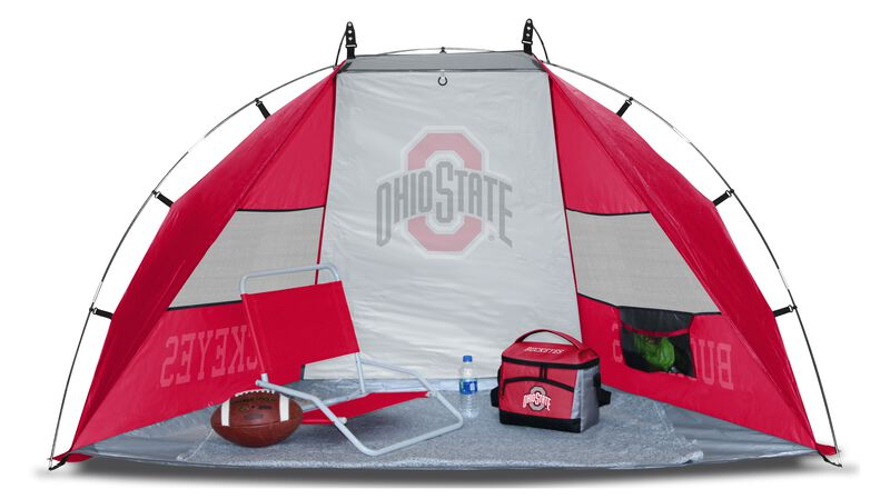 An Ohio State Buckeyes sideline sun shelter set up with a chair, cooler, football and water bottle - SKU: A New England Patriots sun shelter set up on a beach with a chair, football, cooler and water bottle - SKU: 00973042111