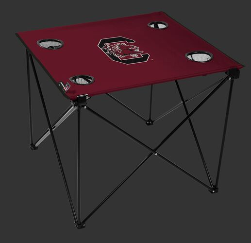 A maroon NCAA South Carolina Gamecocks deluxe tailgate table with four cup holders and team logo printed in the middle SKU #00713098111