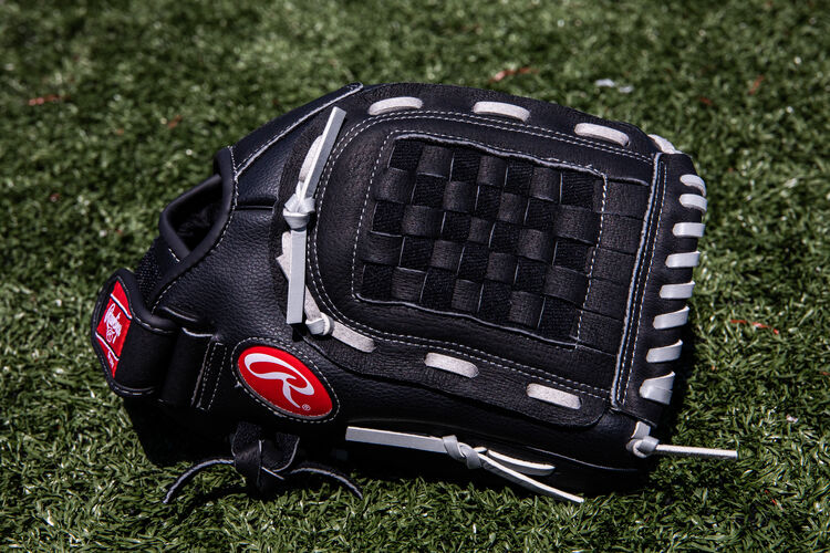 A black RSB recreational infield/pitcher's glove lying on a field - SKU: RSB120GB