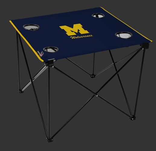 A navy NCAA Michigan Wolverines deluxe tailgate table with four cup holders and team logo printed in the middle SKU #00713083111